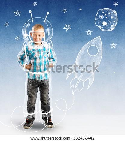 Cute boy as a small astronaut - stock photo