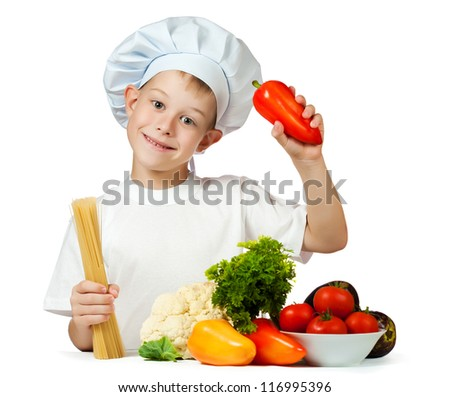 cute boy Chef is holding raw spaghetti and bell pepper