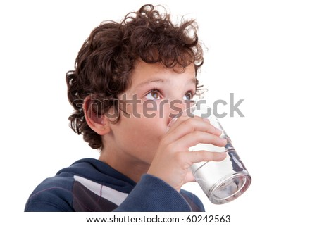 cute boy drinking  water, isolated on white, studio shot