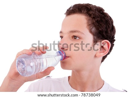 cute boy drinking  water, isolated on white, studio shot - stock photo