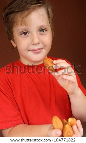 Cute boy eating cakes - stock photo