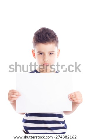 Cute boy holding sheet of paper with empty space for your sample text - stock photo
