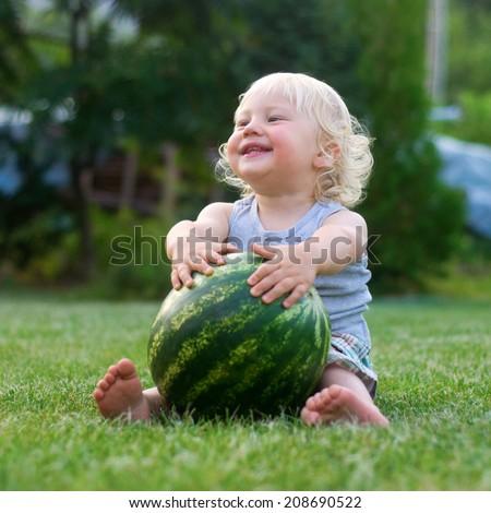 Cute boy holding watermelon  - stock photo