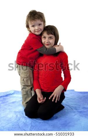 Cute boy hugging pretty girl - stock photo