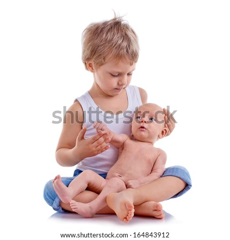cute boy hugs his newborn brother