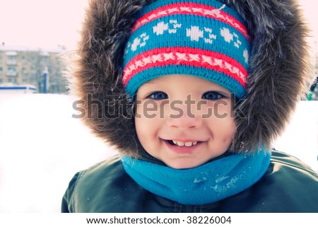 Cute  boy is smiling outdoor snow winter. Christmas time - stock photo