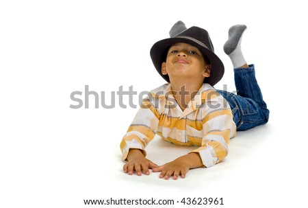 cute boy laying on the floor, isolated on white background - stock photo