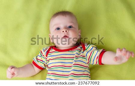 Cute boy lying on his back - stock photo
