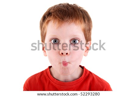 "cute boy making ""funny face"", isolated on white background. Studio shot."