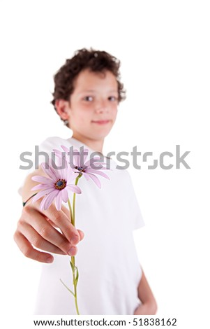 cute boy offering flowers, isolated on white background. Studio shot - stock photo