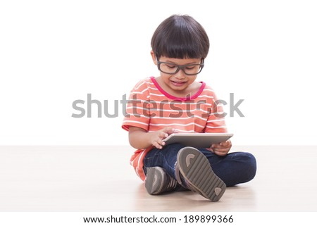 cute boy playing a game on computer tablet  - stock photo