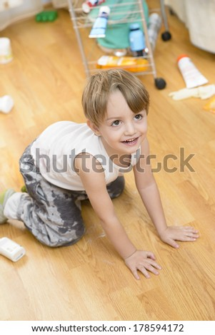 Cute boy playing excited and making a mess - stock photo