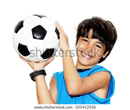 Cute boy playing football, happy child, young male teen goalkeeper enjoying sport game, holding ball, isolated portrait of a preteen smiling and having fun, kids activities, little footballer - stock photo