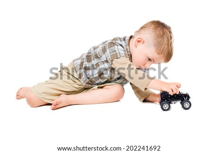 Cute boy playing toy car isolated on white background - stock photo