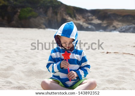 Cute boy playing with a magic wand - stock photo