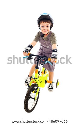 Cute boy riding his bike, being happy
