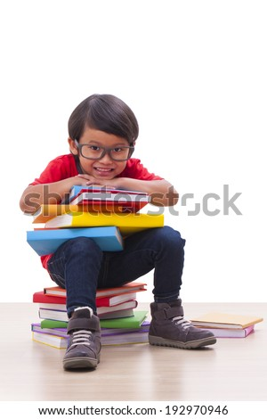 Cute boy sit and holding books