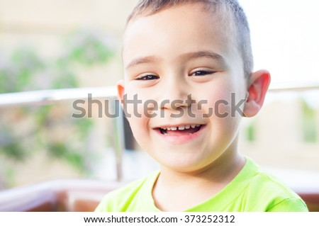 cute boy smiling at outdoor - stock photo
