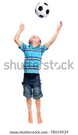 Cute boy throws and  jumps with a football in studio, isolated on white - stock photo