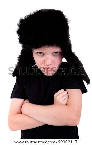 cute boy with a cap, angry, with arms crossed, isolated on white background, studio shot. - stock photo