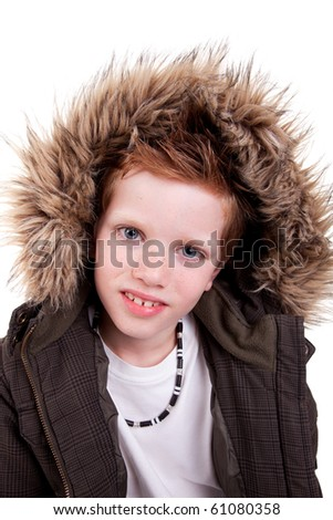 Cute boy with a furry hood, isolated on white background