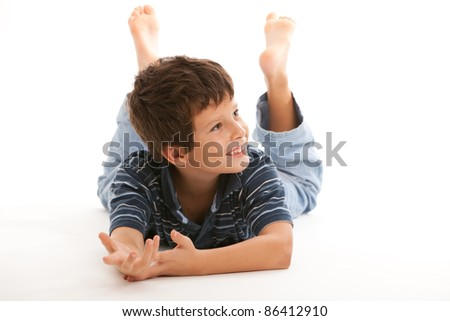 Cute boy with a happy expression isolated on a white background.