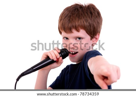 Cute boy with a microphone sings isolated on white, studio shot - stock photo
