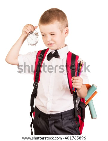 Cute boy with a red backpack in a hurry to school isolated on white background. - stock photo