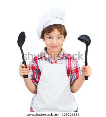 Cute boy with black spoons isolated on white background - stock photo