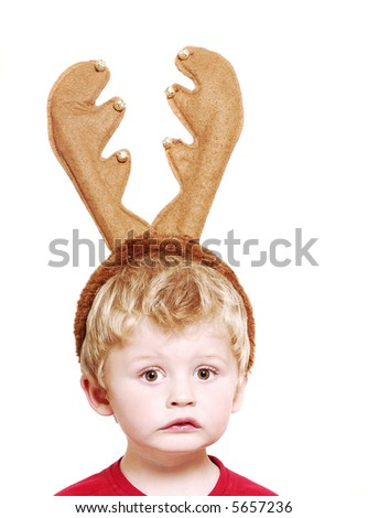 Cute boy with christmas antlers. - stock photo