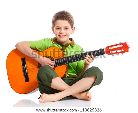 Cute boy with classical guitar. Isolated on white background - stock photo