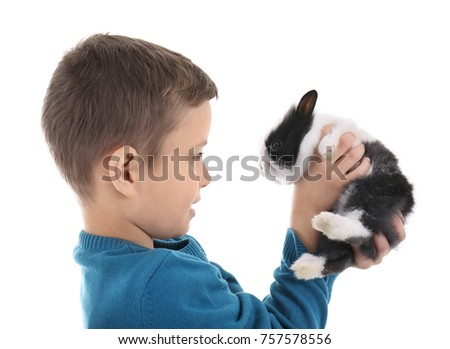 Cute boy with funny rabbit on white background