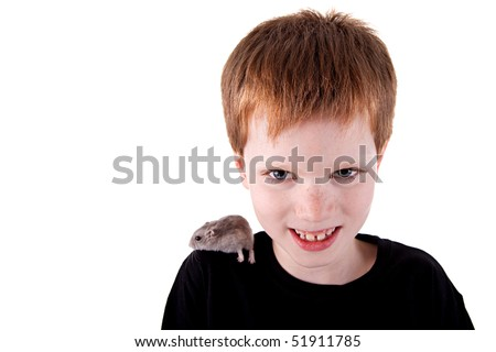 Cute boy with hamster on shoulder,  isolated on white background. Studio shot - stock photo