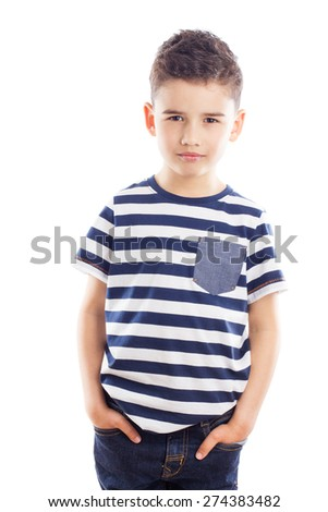 Cute boy with hands in jeans pockets - stock photo