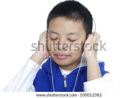 cute boy with headphone listening to music - stock photo