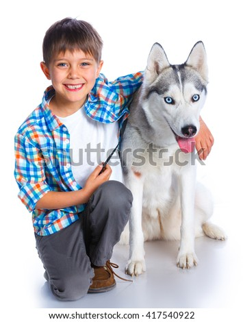 Cute boy with her dog husky isolated on white background - stock photo