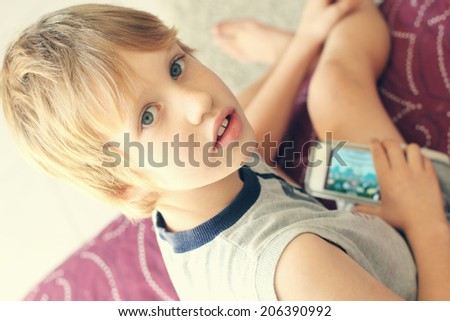 Cute boy with mobile phone - stock photo