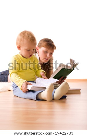 Cute boy with mother reading a book at home. Upper part of image isolated on white - stock photo