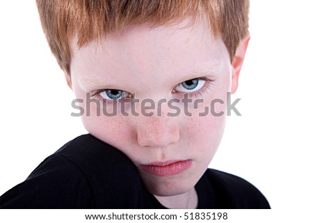 Cute Boy, with sad look,  isolated on white background. Studio shot