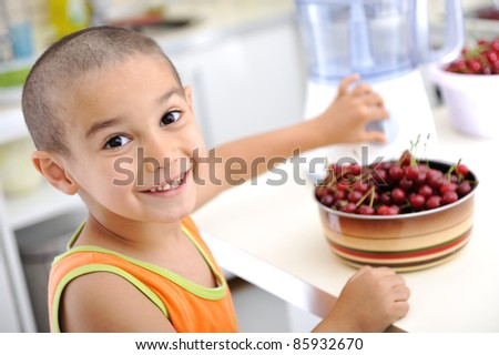 Cute boy with short hair in kitchen - stock photo