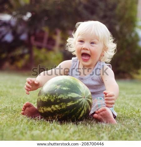 Cute boy with watermelon - stock photo