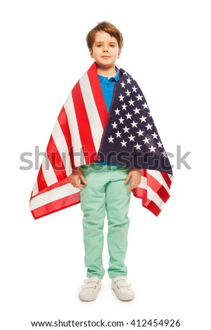 Cute boy wrapped in American flag - stock photo