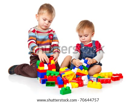 cute boys are playing with the lego. isolated on a white background - stock photo