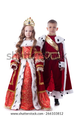 Cute brother and sister posing in royal attire - stock photo