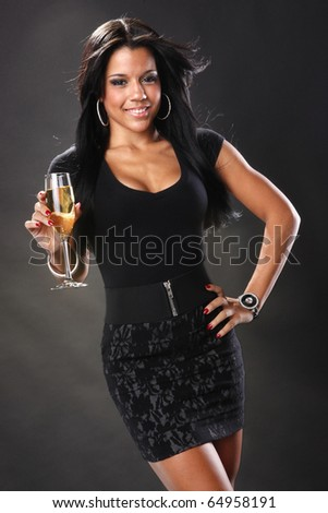 Cute brunette and wine in a flute - stock photo