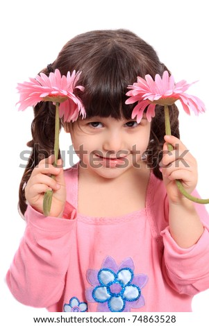Cute brunette four year old girl being shy, hiding behind  colorful pink daisies on a white background - stock photo