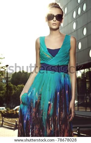 Cute brunette posing on a city street - stock photo