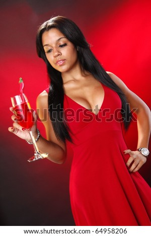 Cute brunette red with red cocktail - stock photo