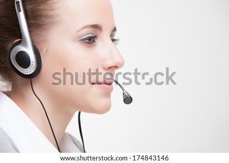 Cute business customer service woman smiling - stock photo
