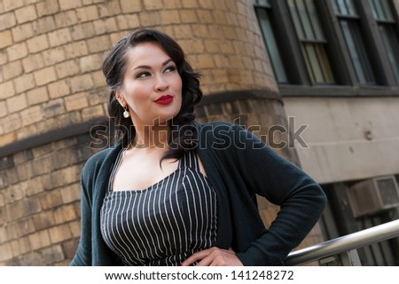 Cute business woman on High Line, NYC - stock photo